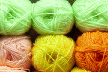 Store shelf with color yarn for knitting with needles, crochet hook.