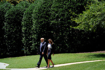 U.S. President Donald Trump walks to Marine One as he departs from the South Lawn of the White House in Washington