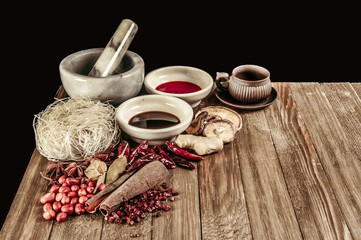 Collection of Chinese cooking spices and flavors on wooden table