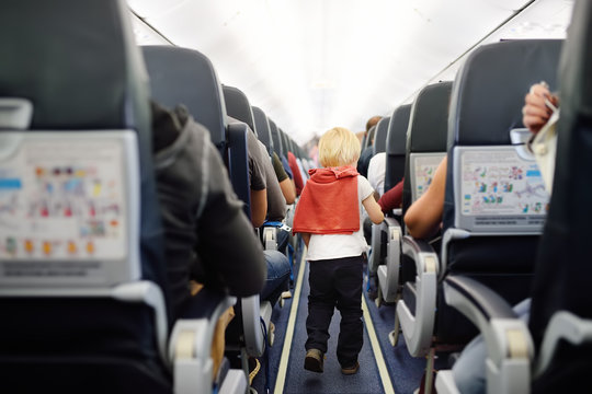 Happy little boy during traveling by an airplane