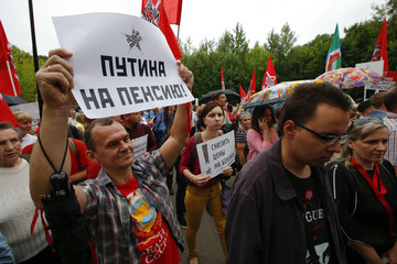 People protest over a government decision to increase the retirement age during a rally in Moscow