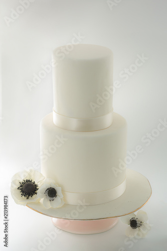 Simple Elegant White 2 Tier Wedding Cake With Edible Flowers Stock
