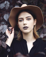 Young woman wearing hat oudoors