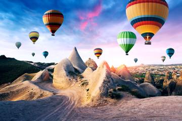 Color balloons in the sunrise sky. Cappadocia, Turkey Wall mural