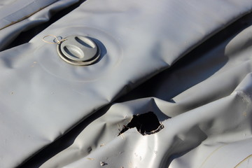 Damaged by mice gray fishing inflatable boat PVC, the rat chewed a hole in the bilge and the shipboard balloon