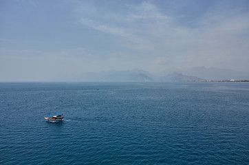A ship with Taurus mountains in Antalya, Turkey