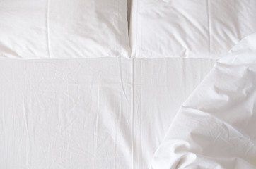 White bedding sheets and pillows