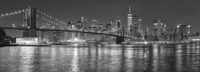 Black and white picture of New York City skyline at night, USA.