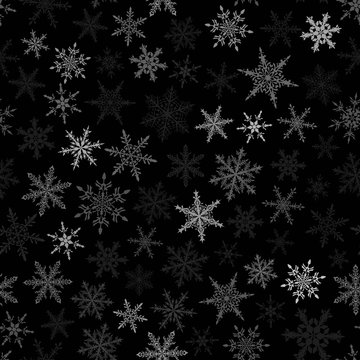 Christmas seamless pattern of snowflakes, white on black background.