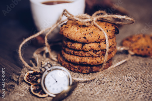 Vintage Clocks And Stacked Chocolate Chip Cookies On