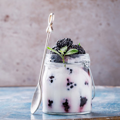 Blackberry with Greek Yogurt and Mint. Fresh Berry.  Useful Breakfast in a Jar. Smoothie Light Meal Natural Food.