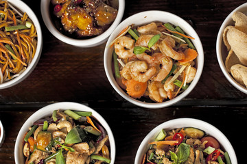 Bowls of fresh asian dishes