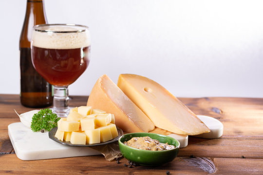 Famous Dutch finger food usually served with glass of beer, cubes hard old Dutch cow and goat cheese with Dijon mustard