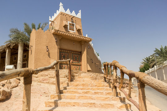Authentic Arabian style house or a tavern with wooden carved door and Arabian decoration pattern in Riyadh, Saudi Arabia