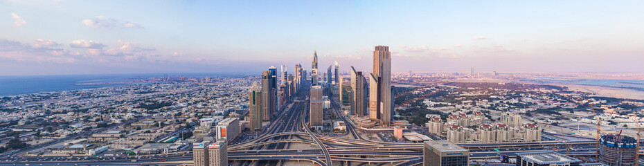 Printed roller blinds Dubai DUBAI, UAE - FEBRUARY 21, 2014. Panorama aerial view on Dubai main street - Sheikh Zayed Road and skyscrapers in evening on sunset
