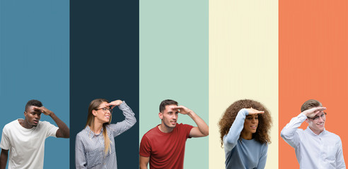 Group of people over vintage colors background very happy and smiling looking far away with hand over head. Searching concept. Wall mural