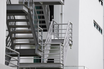Foto op Plexiglas Trappen grey fire exit stair outside of the building.