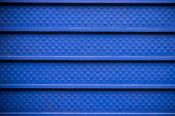 blue steel wall background and texture, blue metal fence with dark vignette background