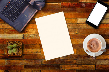 Blank paper on wood office table background.
