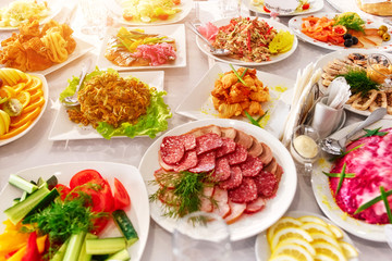 Beautifully decorated catering banquet table with different food snacks and appetizers on corporate, christmas, birthday, party event or wedding celebration