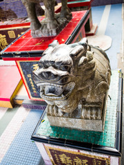 Ancient statue of a lion creatures in the story of China