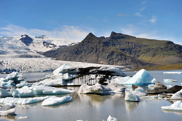 The glacier's sleeve in Iceland meets the sea and here icebergs are formed