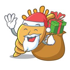 Santa with gift exotic shell mascot cartoon