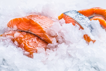 Close-up Fresh raw salmon fillets on Ice