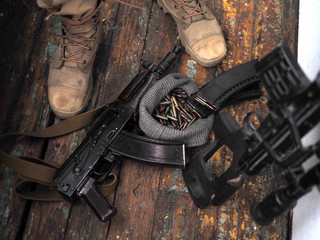soldier feet and AK rifle on the floor. Sniper rifle.