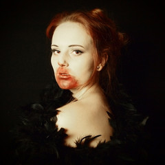 female vampire portayed as a glamourous vamp with art filter