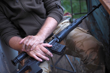 soldier loading a bunch of bullets into a handgun magazine