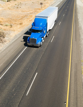 Big Blue Truck Hauling a Load of Freight down the Highway