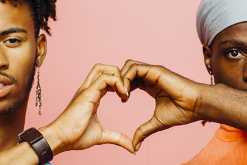 Happy love/ Two men making a heart shape with their hands