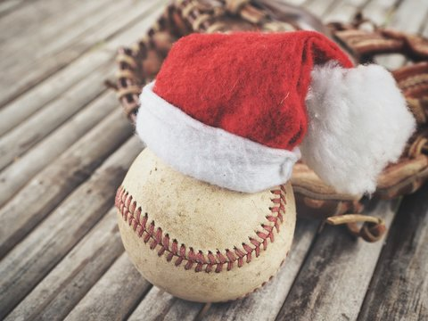 Baseball with leather glove and christmas hat