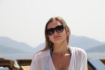 Nice girl near the sea in a sunny day