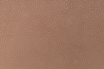 Light brown leather texture surface. Close-up of natural grain cow leather .