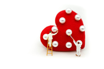 Miniature people: Workers brush painting Red heart,celebrate valentines'day or wedding anniversary  concept.