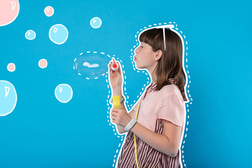 Soap bubbles. Calm cute teenage girl blowing soap bubbles and relaxing