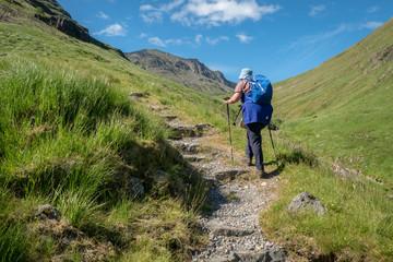 Female hill walker in Glencoe, Scottish Highlands