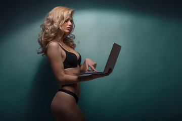 Sexy blonde with laptop