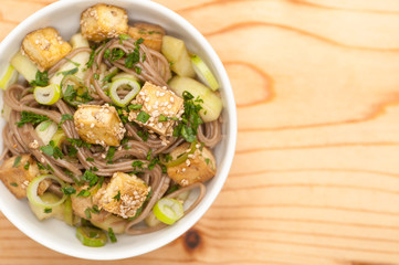 Homemade soba noodle salad with fried Tofu
