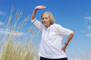 An old woman practicing Tai chi
