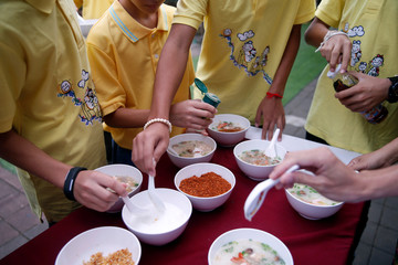 Members of the soccer team rescued from a cave, eat their breakfast during a religious ceremony, in a temple at Mae Sai, in the northern province of Chiang Rai