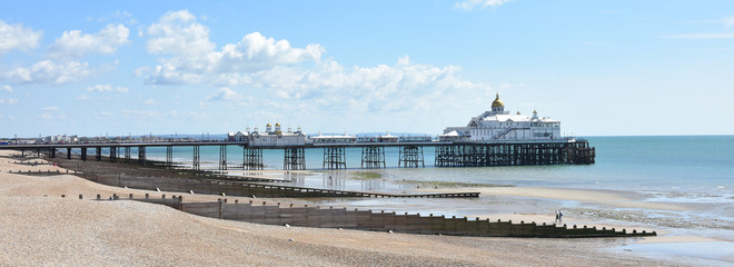 Eastbourne pier and beach, East Sussex, UK on a sunny summer day