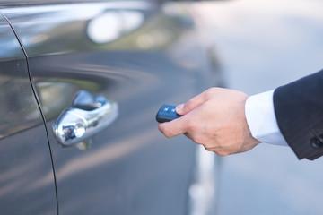 Man in formalwear open car door, Hand on car door handle