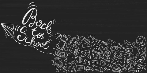 Back to school lettering background with doodle elements on blackboard