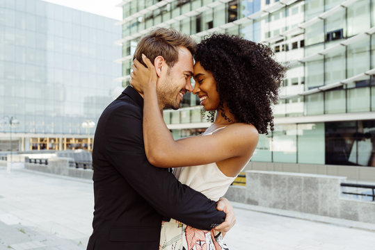 Young couple hugging on street