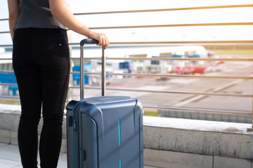 Young woman with suitcase in airtport