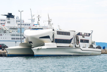 Modern high speed craft moored in the port.