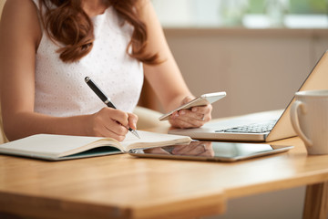 Business lady writing plans and ideas
